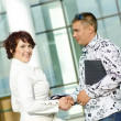 Royalty-Free Stock Photo: Man and woman business handshake