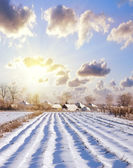 Snow in village, the house on a hill — Stock Photo