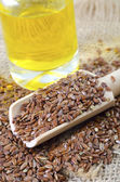 Linseed oil and flax seeds — Stok fotoğraf