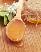 Honey in spoon — Stock Photo