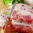 Raw meat on wooden board — Stock Photo