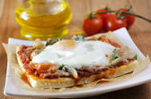 Pizza with egg — Stock Photo