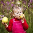 Stock Photo: Little girl and apple