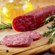 Salami with rosemary — Stock Photo