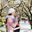 Pregnant woman with fresh red apple in winter — Stock Photo