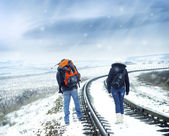 Tourists on winter railroad — Stock Photo