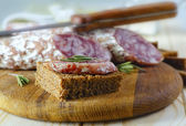 Bread with salami — Stock Photo