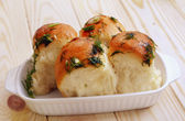 Home made buns with garlic and green parsley — Stock Photo