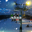 Ride in chairlift at night — Stock Photo #9303826