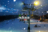 Ride in the chairlift at night — Stock Photo
