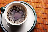 Heart in a cup of coffee — Stock Photo