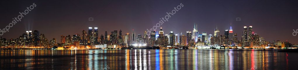 New York City Manhattan midtown skyline at night with lights reflection over Hudson River viewed from New Jersey Weehawken waterfront. — Stock Photo #8577930