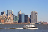 New York City Manhattan skyscrapers and boat — Stok fotoğraf