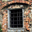 Prison window of a medieval castle — Stock Photo