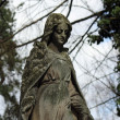 Royalty-Free Stock Photo: Statue of woman on tomb as a symbol of depression pain and sorrow