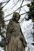 Statue of woman on tomb as a symbol of depression pain and sorrow — Foto Stock