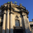 Facade of the Dominican church in the old part of Lviv — Stock Photo #9248534