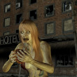 Zombie woman in front of an old hotel - Stock Photo