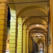 Arcades in Bologna by night, Italy — Stock Photo