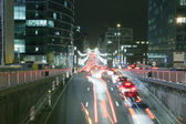 Night traffic and busy nightlife in Brussels — Stock Photo