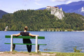 Woman on Bench, enjoys summer day — Stock Photo