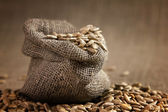 Small burlap sack with seeds — Stock Photo