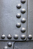 Metal surface with rivets — Stock Photo
