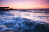 Beautiful seascape with big sea wave at the sunset — Stock Photo