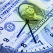 Royalty-Free Stock Photo: Clock and banknotes.