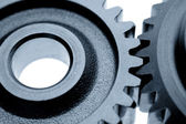 Closeup of two cogs on plain background — Stock Photo