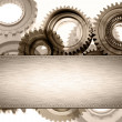 Stock Photo: Steel panel on cogs. Copy space