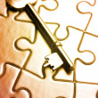 Key on puzzle — Stock Photo