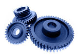 Three cogs on plain background — Stock Photo