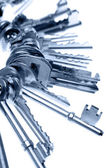 Bunch of keys on plain background — Stock Photo