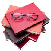 Reading glasses on books — Stock Photo