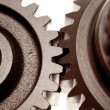 Stock Photo: Two gears meshing together