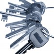 Bunch of keys on plain background - Stockfoto