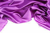 Purple silk fabric on plain background — Stock Photo