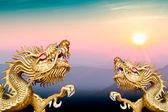 Twin golden dragon on morning sunrise — Стоковое фото