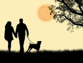 Silhouette of a couple walking their dog on sunset — Stock Vector