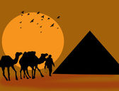 Silhouette of camels and pyramid against a sunset sky — Stock Vector