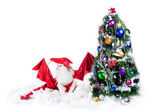 Cat on the background of the Christmas Tree — Stock Photo