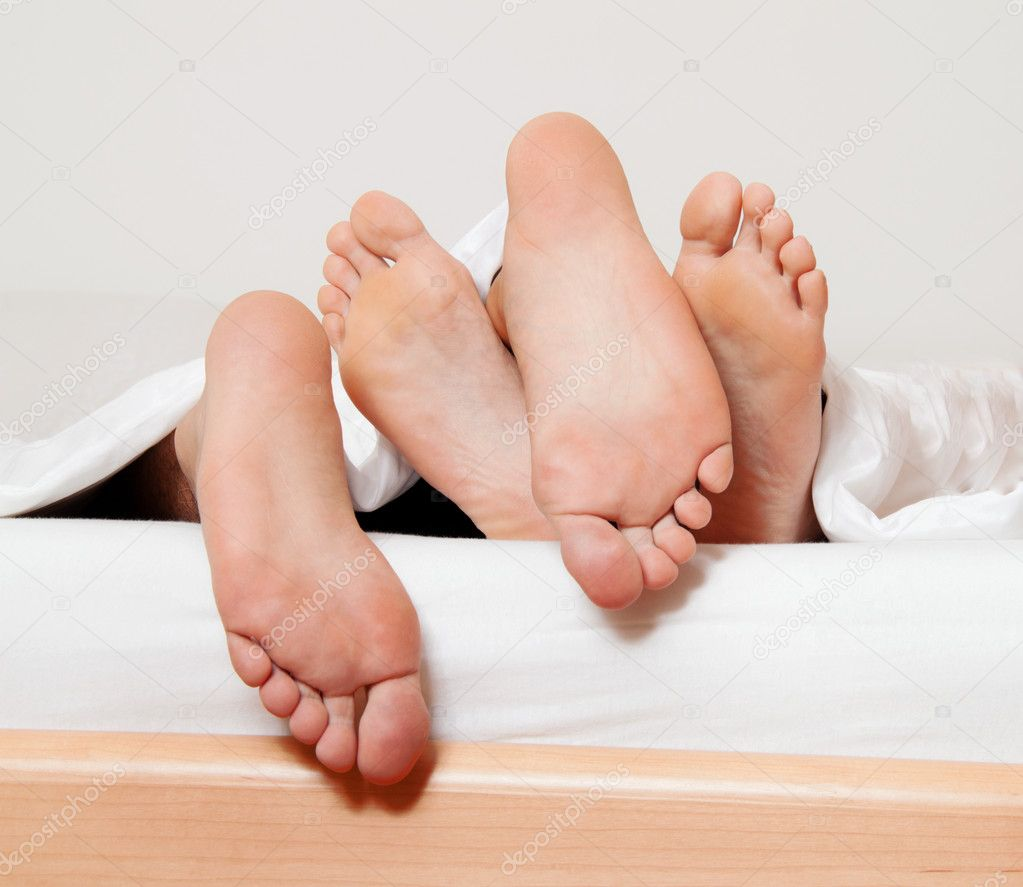 Dents a couple feet in bed. love, sex and partners. — Stock Photo #10001040
