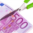 Euro banknotes and scissors — Stock Photo #10428381