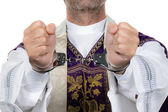 Catholic priest in handcuffs. abuse — Stock Photo