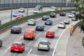 Jam in traffic with cars on a highway stras — Stock Photo