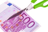 Euro banknotes and scissors — Stock Photo