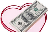 U.s. dollars bills in a heart — Stock Photo