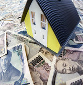 Japanese yen and the house — Stock Photo