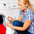 Housewife with washing machine — Stock Photo